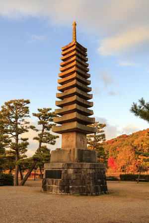 storied: KYOTO, JAPAN -NOV 24, 2012: Thirteen storied stone pagoda (13-tiered stone pagoda) on To-no-shima Island, Uji city, Kyoto. This pagoda first built in 1286 as part of prayer of compassion for animals. Editorial