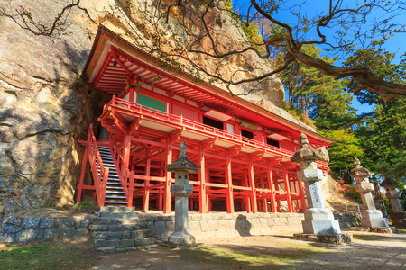 national historic site: IWATE, JAPAN -OCT 27, 2012: Takkoku no Iwaya Bishamondo Temple, the National Historic site of Japan in Iwate prefecture. This temple built in the rock wall of a cliff about 1,200 years ago.