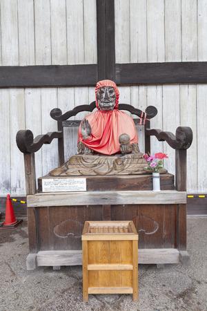 ailment: NARA, JAPAN - NOV 26, 2012: Binzuru Pindola wooden statue in Todai-ji Temple, Nara, Japan. Japanese believed that when a person rubs a part of this statue, his ailment there will disappear.