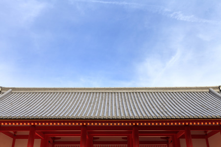 japan sky: Japanese temple roof against blue sky, Kyoto Imperial Palace, Kyoto, Japan. (Sky space composition for text) Editorial