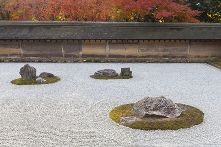 karesansui: Japanese Dry landscape rock garden in autumn at Ryoanji (or Ryoan-ji), a Zen Buddhist temple in Kyoto, Japan. It is a UNESCO World Heritage Site.