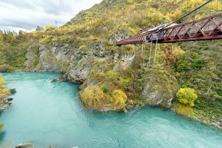 QUEENSTOWN, NEW ZEALAND -MAY 10, 2016: The Kawarau Gorge Suspension Bridge for Bungy Jumping into Kawarau river. Commercial Bungy Jumping was born here in 1988.