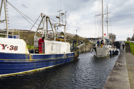 longest: FORT WILLIAM, SCOTLAND - APR 12, 2016:: Boat at Neptunes Staircase lock on the Caledonian Canal, the longest staircase lock in Britain at Fort William, Scotland, UK. Editorial