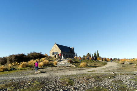 LAKE TEKAPO, NEW ZEALAND- MAY 06, 2016: Unidentified Tourists at the church of the good shepherd at Lake Tekapo. This Church built in 1935 as a memorial to the pioneers of the Mackenzie Country. Editorial