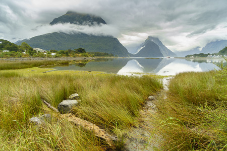 Milford Sound (Piopiotahi in Maori) in cloudy day, a fjord within Fiordland National Park, Piopiotahi (Milford Sound) Marine Reserve, and the Te Wahipounamu World Heritage site, New Zealand. Stock Photo