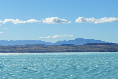 Lake Pukaki and the Southern Alps mountain range in the Aoraki Mount Cook National Park, Canterbury region, South Island, New Zealand. Stock Photo