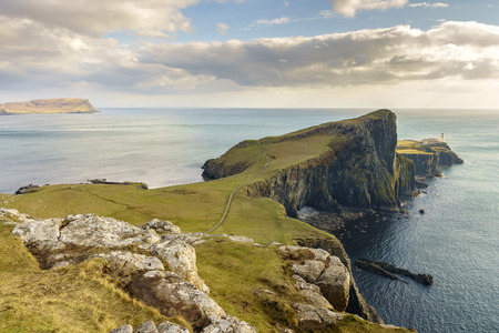 highland: Neist Point cliff, a famous landmark with a lighthouse near Glendale, Isle of Skye, Scotland, United Kingdom.