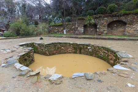 baptismal: Ancient baptismal fish shaped bathfont water fountain or well nearby the House of Virgin Mary in Turkey, believed by some pilgrims to have miraculous powers of healing or fertility.