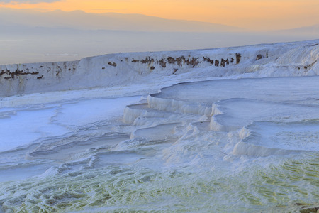 Travertine pools and terraces in evening at Pamukkale, Denizli, Turkey. Stock Photo