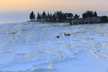 Dried Travertine pools and terraces in evening at Pamukkale, Denizli, Turkey.