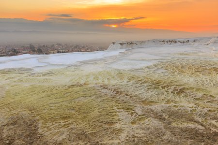 Sunset at Pamukkale with its travertine pools and terraces as foreground, Denizli, Turkey.