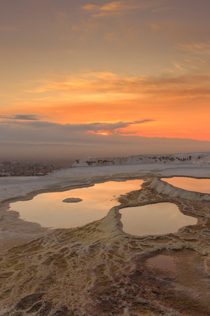 natural formation: Sunset at Pamukkale with its travertine pools and terraces as foreground, Denizli, Turkey.