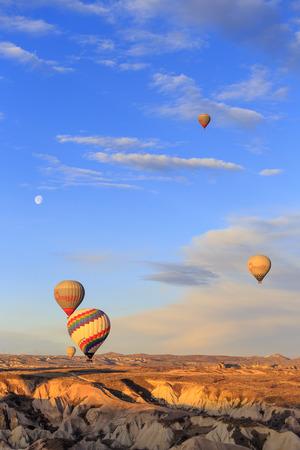 GOREME, TURKEY -JAN 30, 2013: Colorful Hot air balloon fly over Cappadocia, Goreme, Central Anatolia, Turkey. Hot-air ballooning is very popular tourist activity in Cappadocia. Editorial