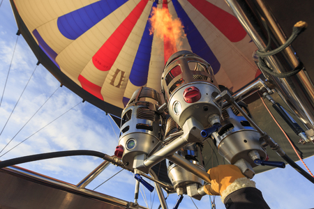 Burners ignite heating up the air into hot air balloon.
