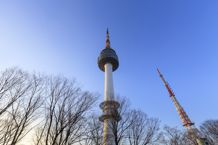SEOUL, SOUTH KOREA - DEC 18, 2012: N Seoul Tower against morning blue sky in Seoul, Korea. Built in 1969,since then, the tower has been landmark and marks the highest point in Seoul.