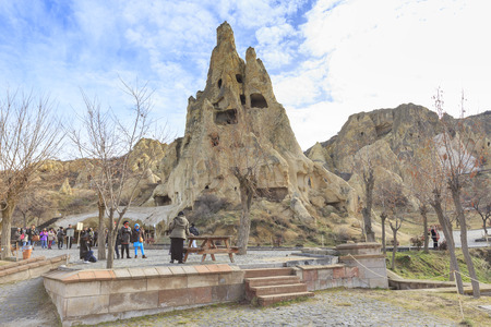 GOREME, TURKEY -JAN 30, 2013: Geological rock formations of volcanic tuff with cave dwelling in Goreme Open Air Museum, a UNESCO World Heritage Site since 1985 in Cappadocia, Central Anatolia, Turkey. Editorial