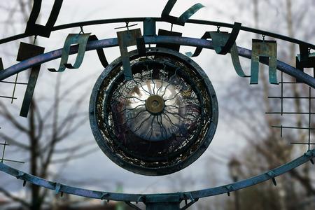 depicting: art object depicting metallic eye
