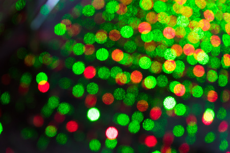 laser lights: defocused bokeh laser lights on street Stock Photo