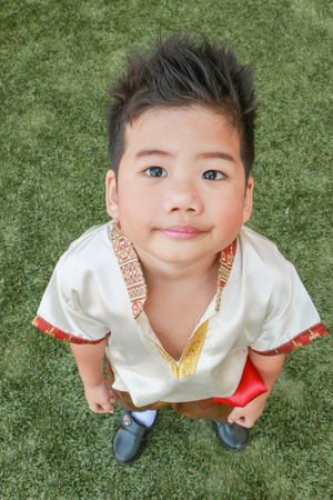 A Cute Boy In Thai Dress Stand On The Yard Stock Photo 72934068