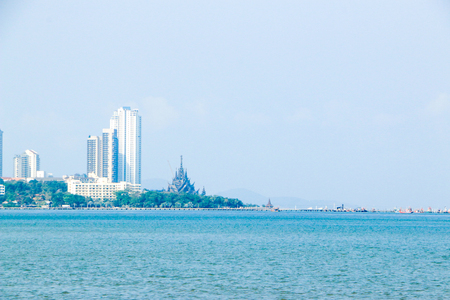 a beach with a building in background Stock Photo