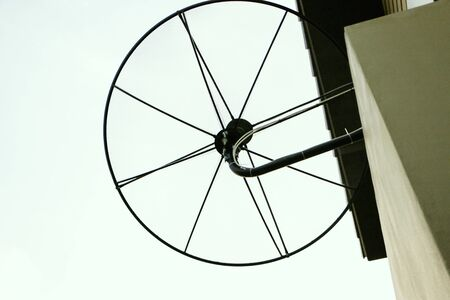 Satellite dish stuck behind the house