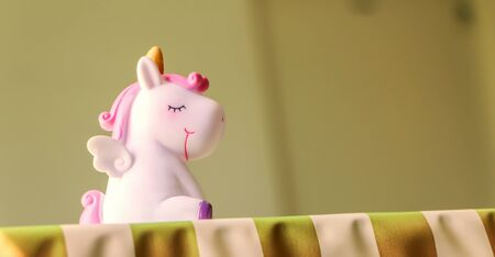 A cute unicorn cartoon character with eyes closed