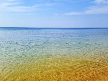 Beautiful evening sea with sea horizon and clear sky.