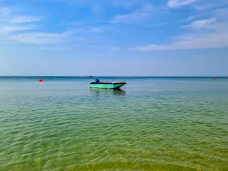 The sea, the horizon and the small fishing boats Standard-Bild
