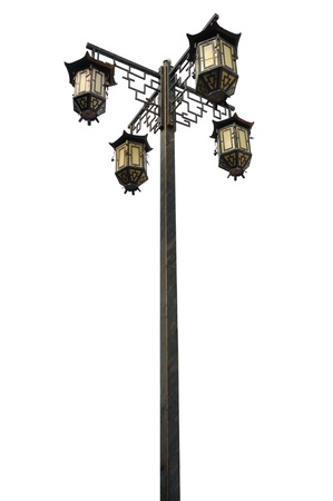 metall lamp: Old-fashioned black metal lantern with four lamps on white background isolated Stock Photo