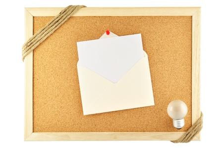 noteboard: Envelope pinned on cork notice board Stock Photo