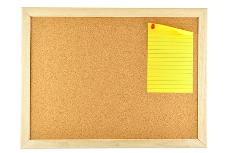 noteboard: yellow paper sticky note pinned on cork notice board Stock Photo