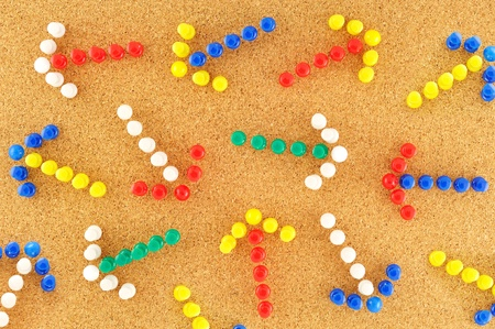 clutter: colorful arrows with random pined on cork board