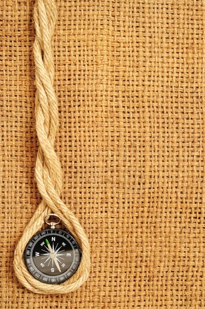 frame of compass and ropes on sack photo