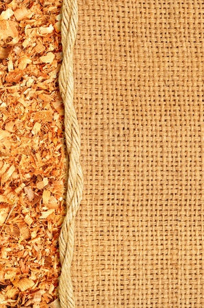 Sawdust flakes piled on logs of sack photo