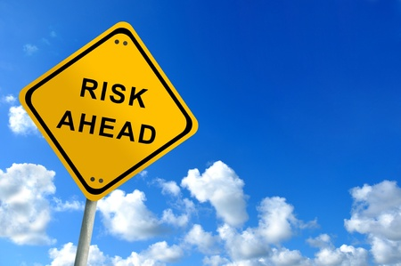 risk ahead traffic sign on bluesky photo