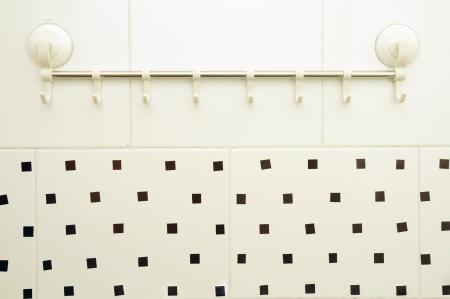 privy: bathroom hook stuck on the wall Stock Photo