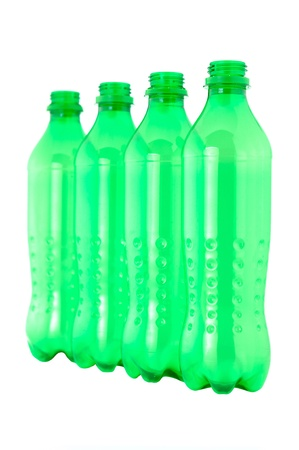 waste products:  used plastic green bottles on white background