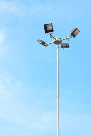 A streetlamp 4 way light with little cloud sky. Stock Photo - 7140392