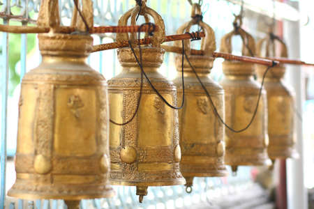 The line of thai style old gold bell. In perspective. Stock Photo - 7162126