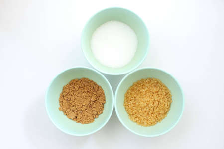 suger: Suger 3 type, brown suger, crystalline sugar and granulated sugar. Stock Photo