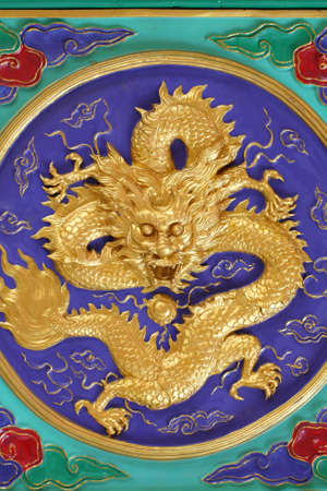 A golden dragon in chinese style. On ceiling. photo
