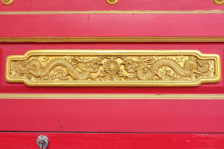 Double golden dragon in chinese style. On red wood. photo
