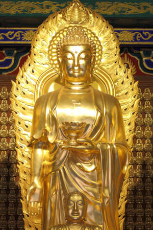 A big golden buddha in chinese style. photo