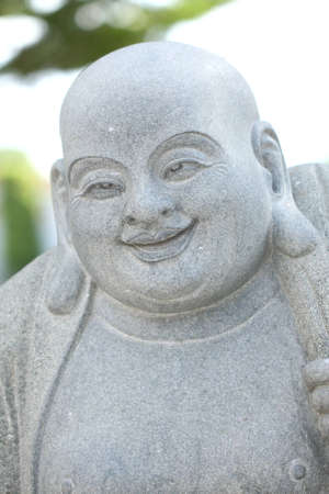 A modeling of fat monk chinese style. photo