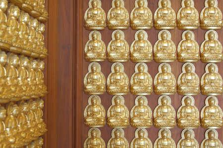 pattern of gold buddha doll on the hard wood. photo