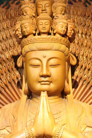 buddha hand: The big kuan has thousand hands. Statue from woods.