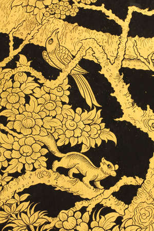 Golden bird and squirrel in Thai style painting. photo