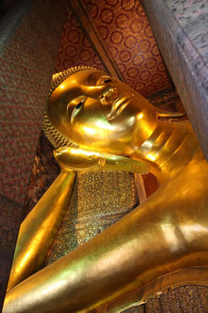 Big Golden Reclining Buddha, Wat Pho, Bangkok, Thailand. photo