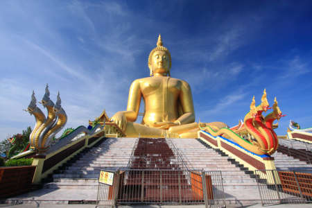 snakes and ladders: Big golden buddha with blue sky, Ang Thong province, Thailand. Stock Photo