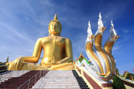 snake and ladder: Big golden buddha with blue sky, Ang Thong province, Thailand. Stock Photo